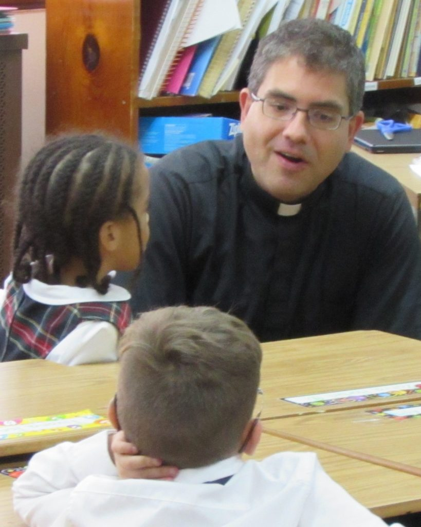 Fr. Mike with student